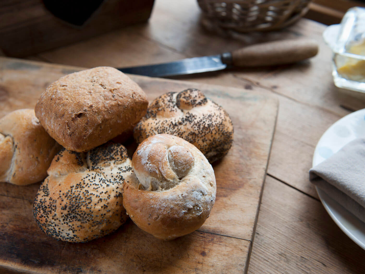 Freshly Baked Bread Rolls On A Kitchen Table