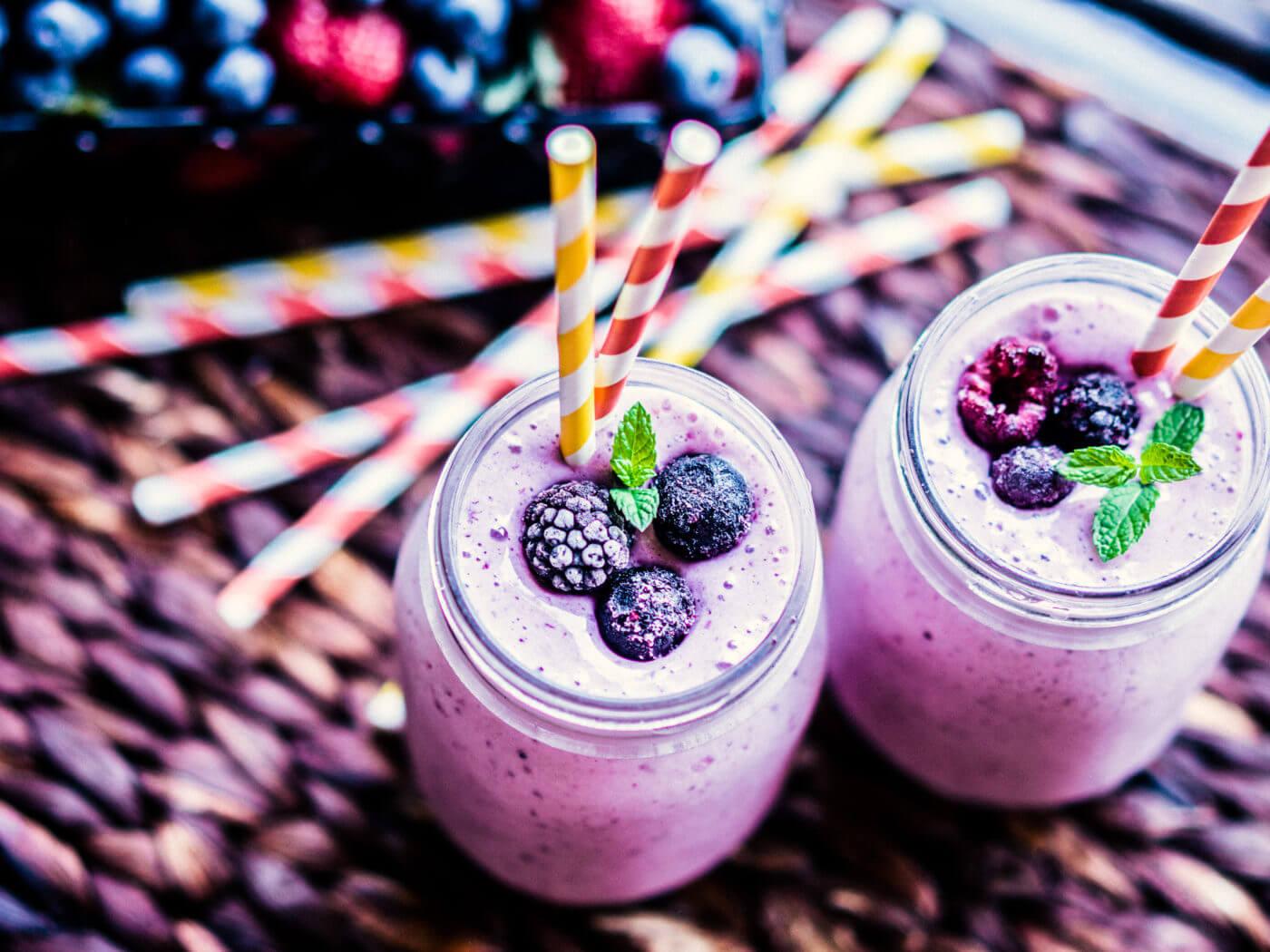 Fresh berry smoothies on mason jars