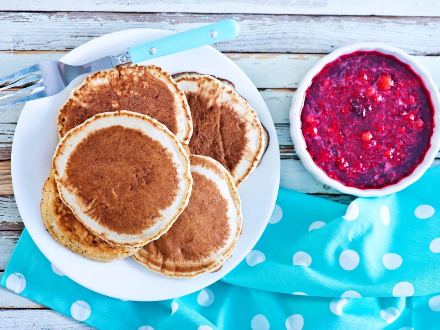 sweet pancakes with jam on the plate