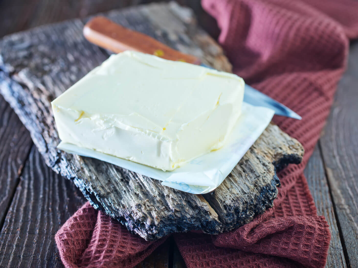 butter on wooden board and on a table
