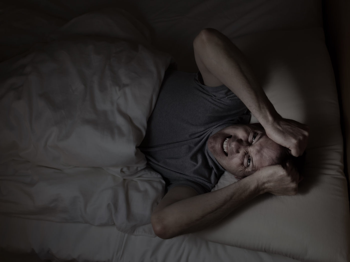 Top view image of mature man showing anger from insomnia