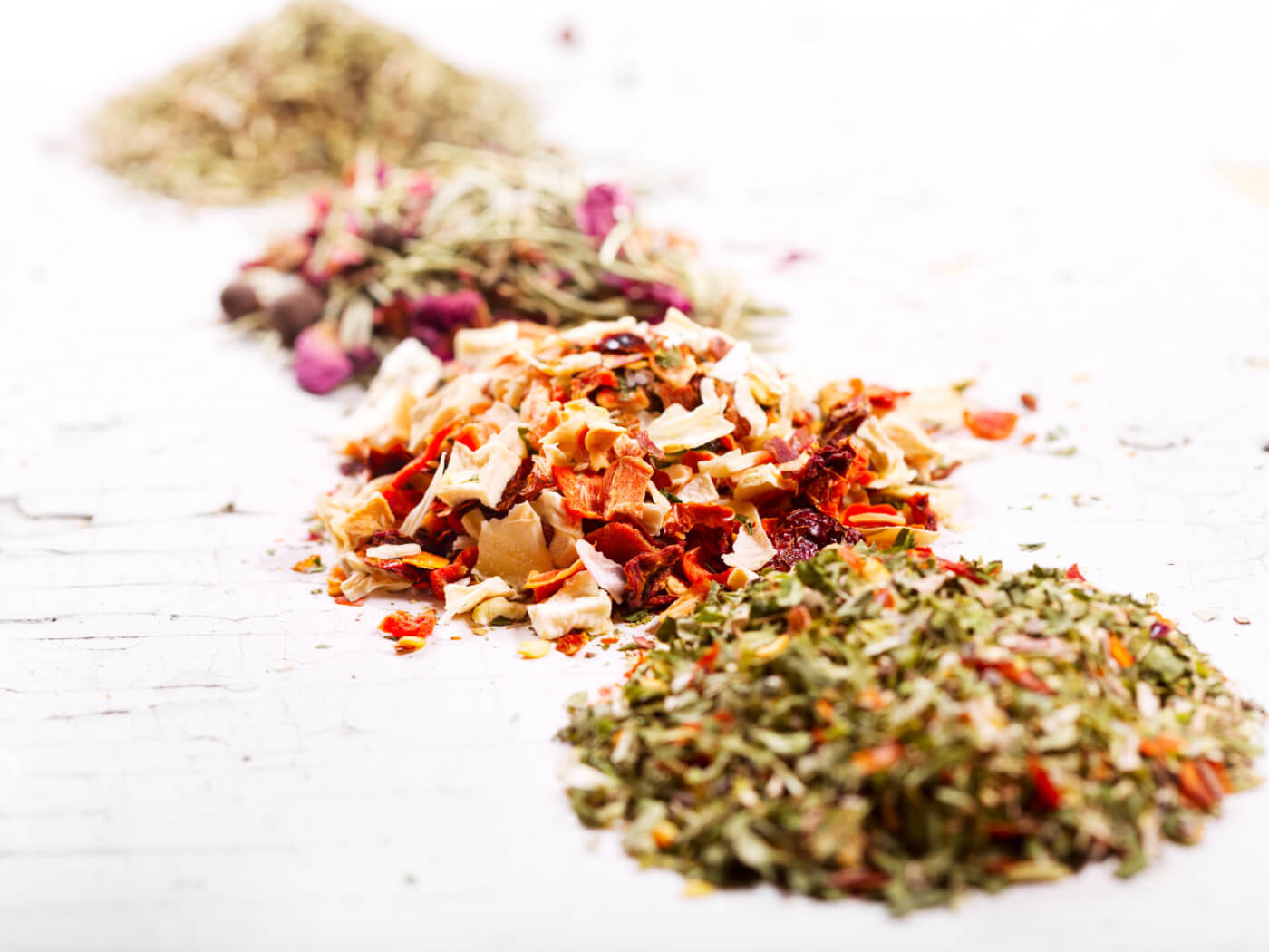 various dried herbs on old wooden table