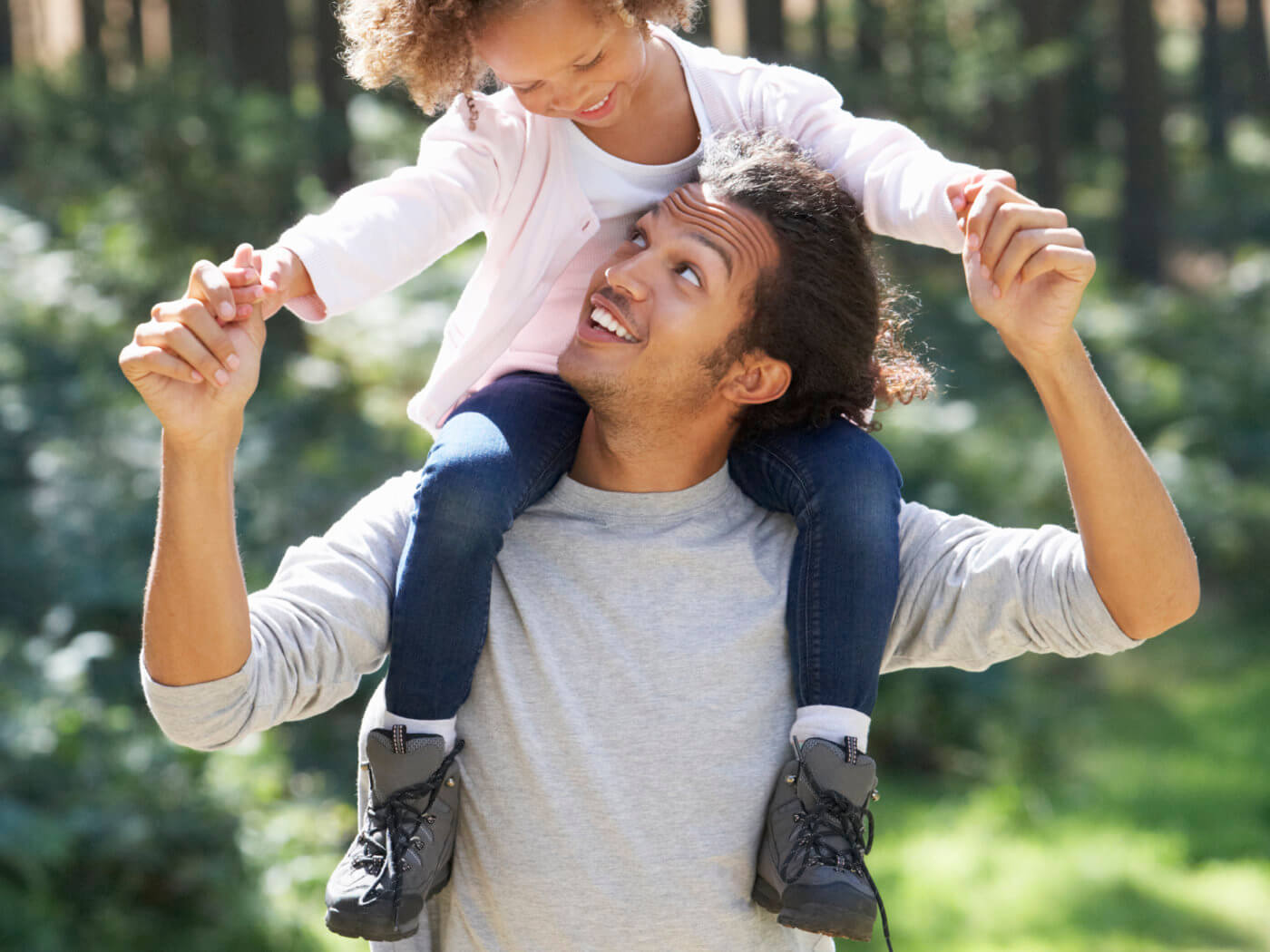 Father Giving Daughter Ride On Shoulders In Countryside