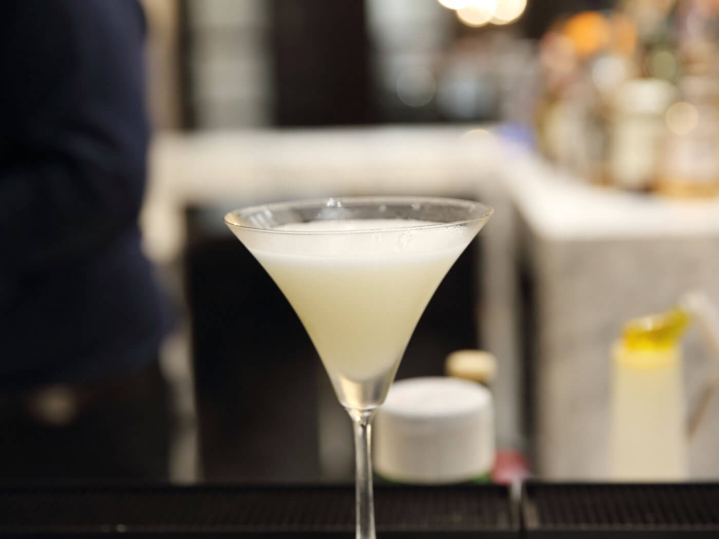 White cocktail in bar background